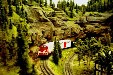 An MTH SOO ALCO climbs a grade with a freight local in the Canadian Rockies