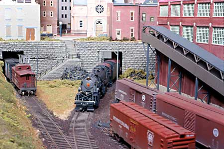 PRR #376, a Proto 2000 Heritage Y-3 2-8-8-2, is entering the Mount Penn Yard from one of two tunnels under the city.