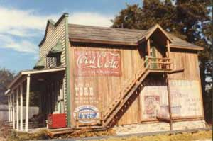 A hot summer day down at old Dry Store...Man, one of the Cokes would sure taste good!